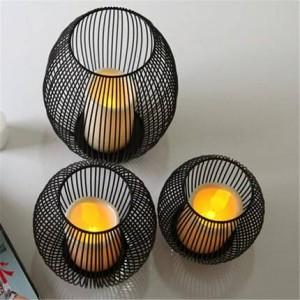 Candelabro de hierro forjado europeo accesorios de cena a la luz de las velas artesanía adornos adornos jaula de pájaros mediterránea lámpara de viento